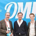Geschäftsführer Patrick Pietruck mit MArc Rath und Thomas Middelhoff auf der OMK in Lüneburg