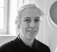 Mitarbeiterfoto von Malisha Hüllenkremer in Schwarz-Weiß