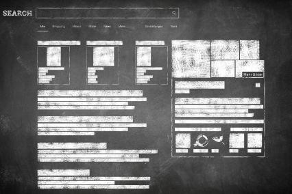 Google-Suchschlitz und SERPs als Tafelbild