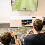 Spielzimmer bei der Online-Agentur web-netz mit Playstation und Spielteppich